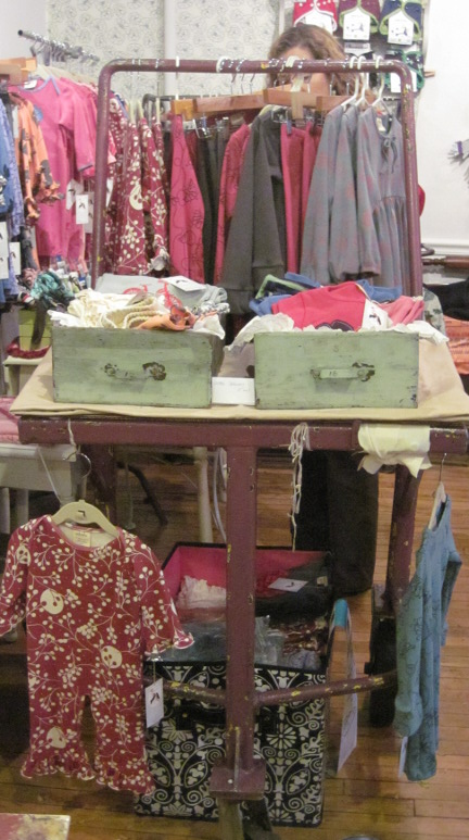 Vintage industrial cart as store garment rack fixture
