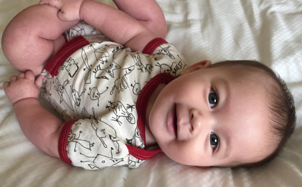 Baby wearing Adooka Organics People romper